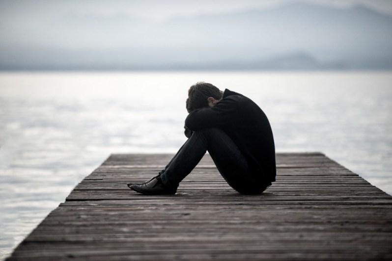 bigstock-Lonely-sad-man-sitting-on-a-do-59078042-1024x683