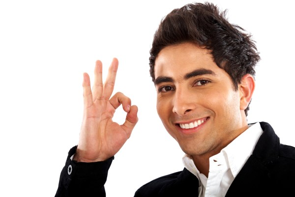 business man smiling doing the okay sign