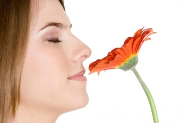 woman-smelling-flowers