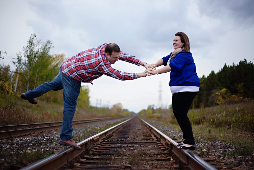 Cornwall engagement session - man falling off train track