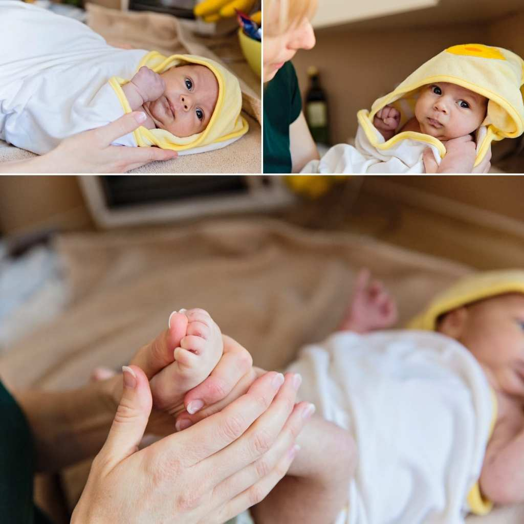 Cornwall documentary family photographer - baby in duck towel