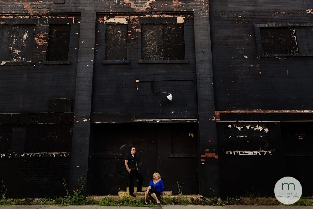 man and woman in front of black building