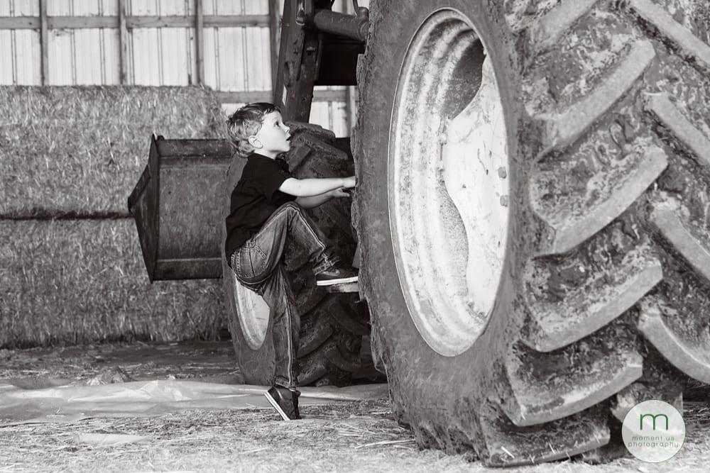 boy climbing on tractor