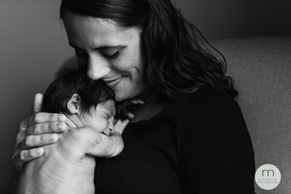 Cornwall mom cuddling newborn daughter