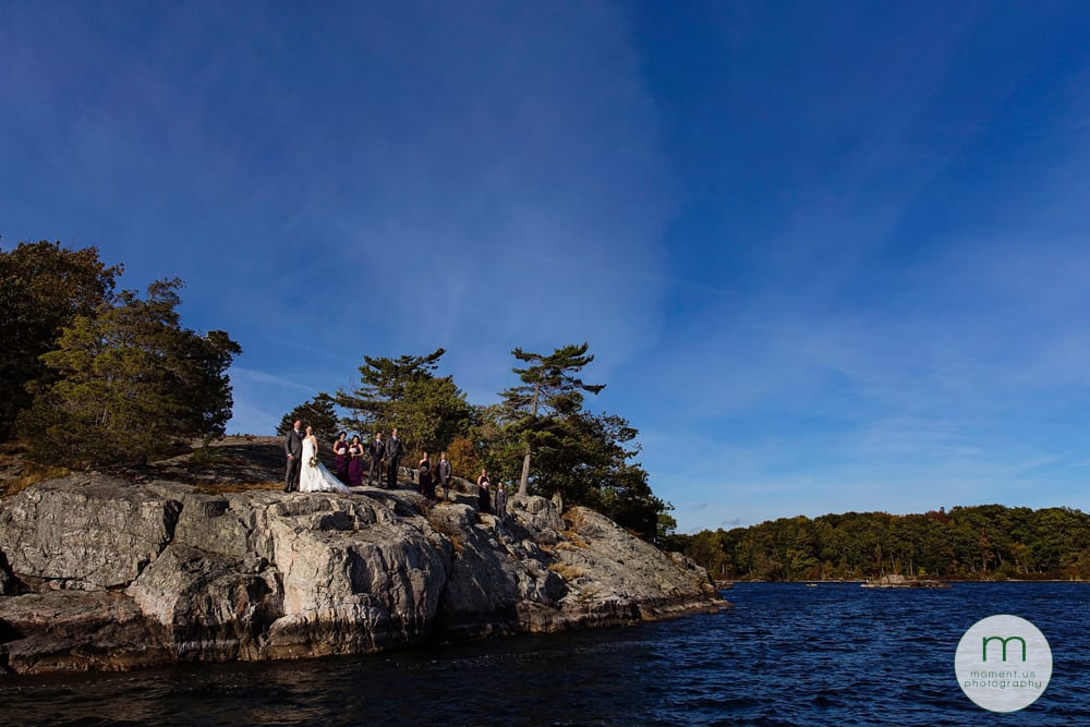 1000 Islands waterfront wedding party on rocky cliff