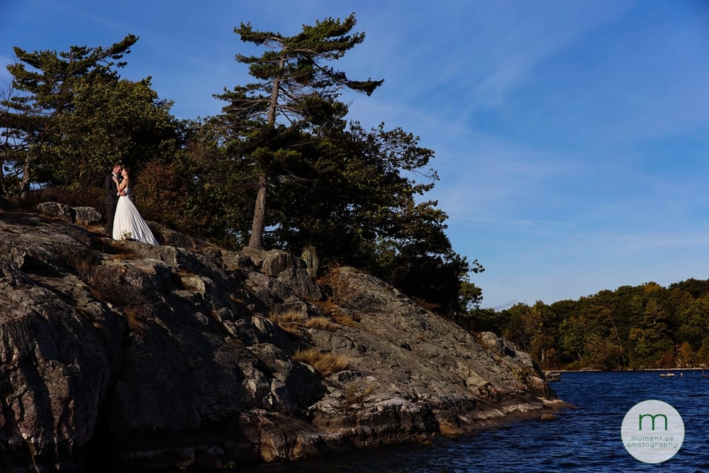 bride and groom on rocky cliff