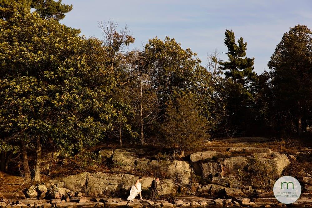 1000 islands wedding bride walking on rocks by bay