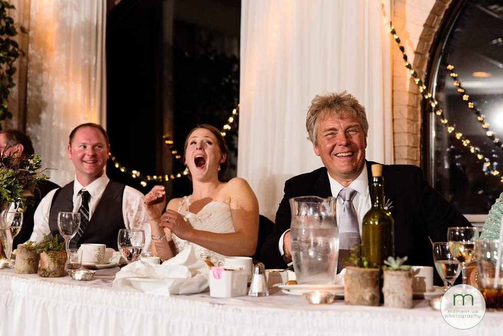bride laughing during dinner