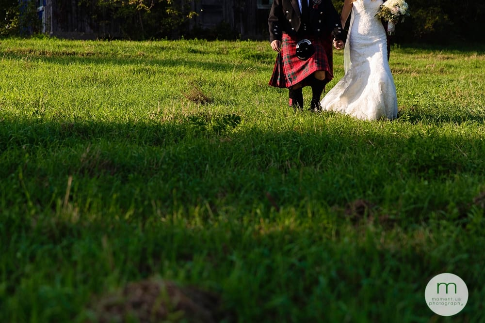 Cornwall Rustic Country Wedding -  bride and groom walking through grass