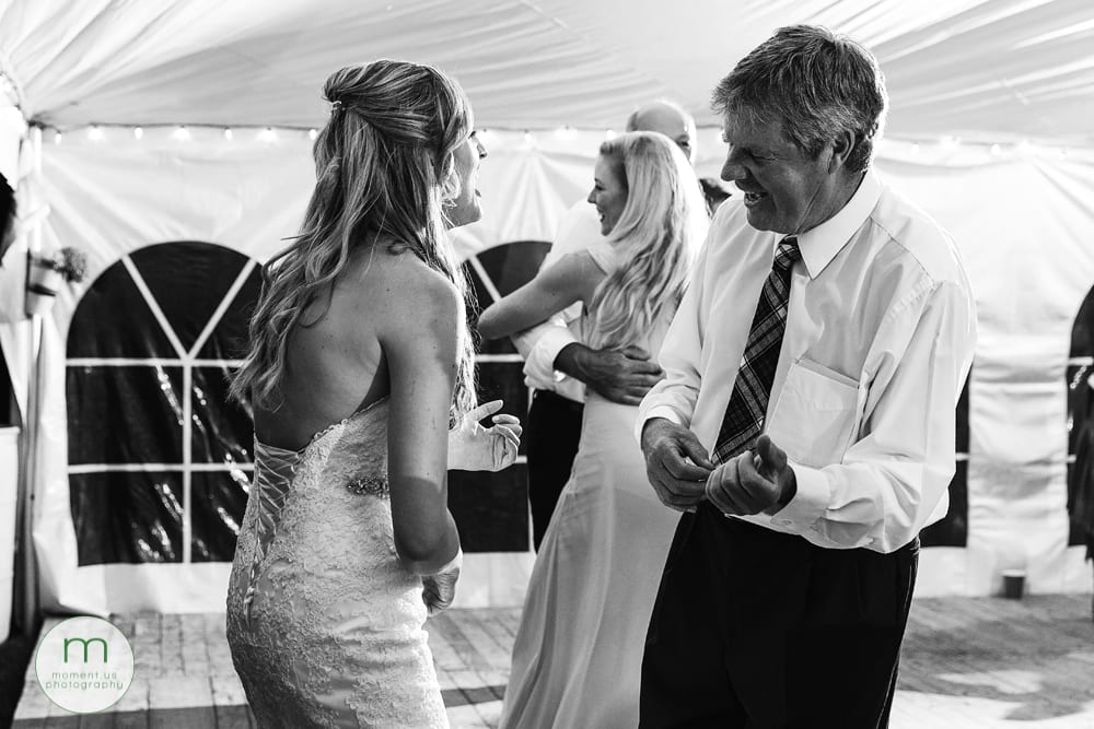 Cornwall Rustic Country Wedding - bride doing air guitar with dad