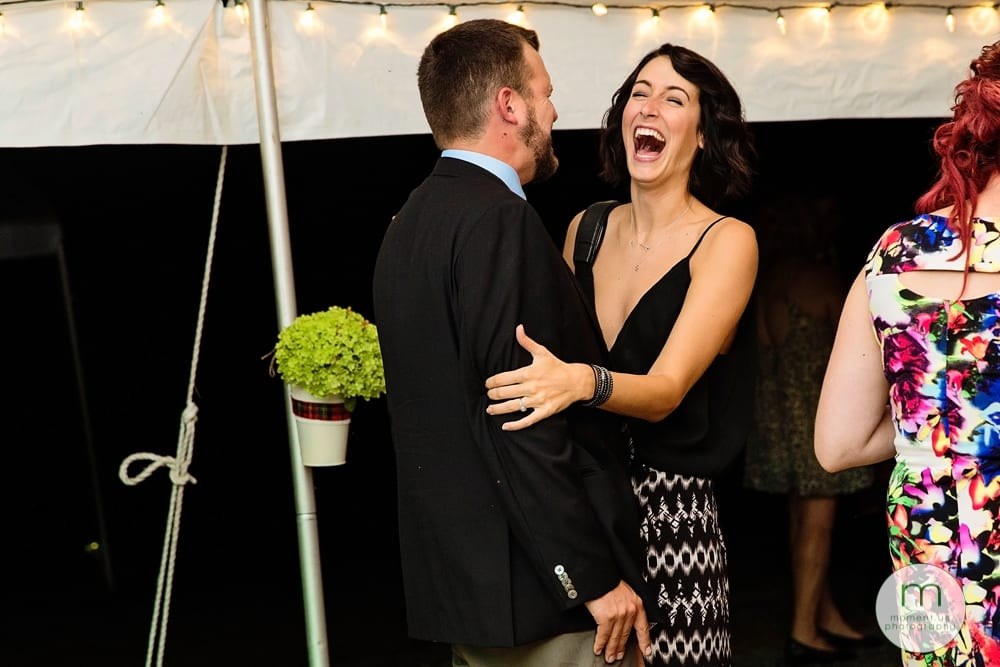 Cornwall Rustic Country Wedding - guest laughing with partner