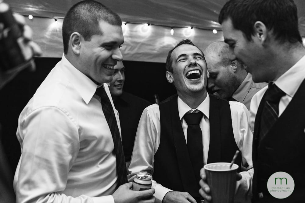 Cornwall Rustic Country Wedding - groom laughing with friends