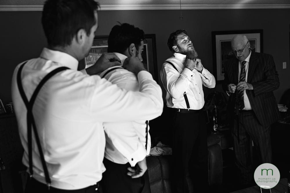 groomsmen doing up ties