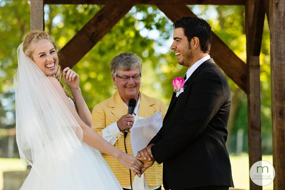 bride laughing during Maxville Fairground wedding ceremony