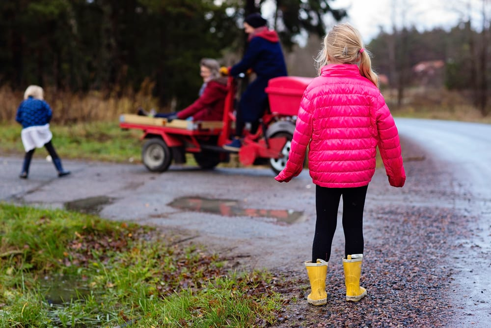 Stockholm girl watching family arrive at school