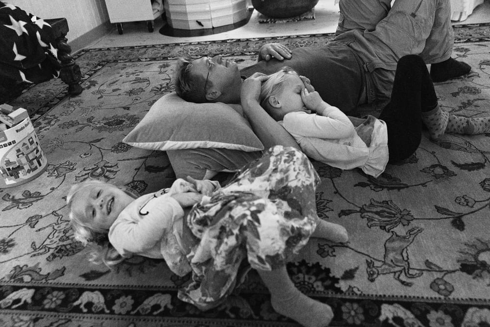 Stockholm family lying on floor
