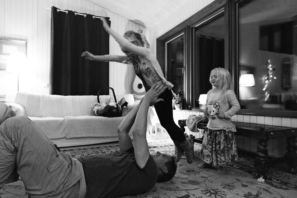 Stockholm family playing on floor