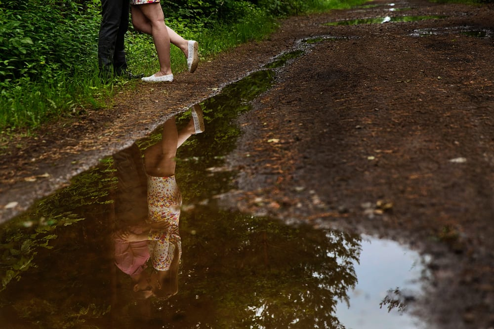 Ontario wedding photographer - couple cuddling for Cornwall engagement photos along dirt road