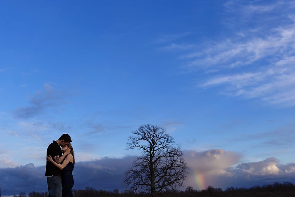 kiss and rainbow during Cornwall engagement session