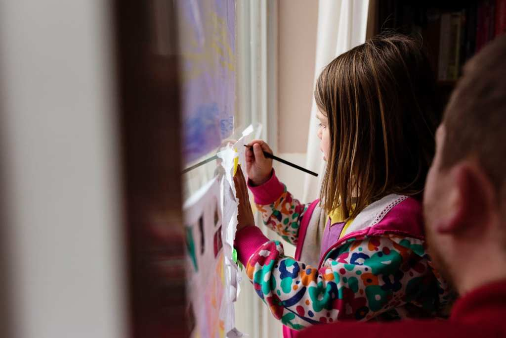 girl drawing in window