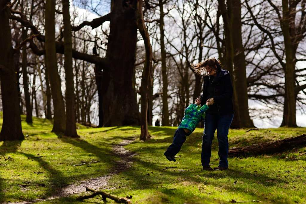 Mom swinging son during London family photography session