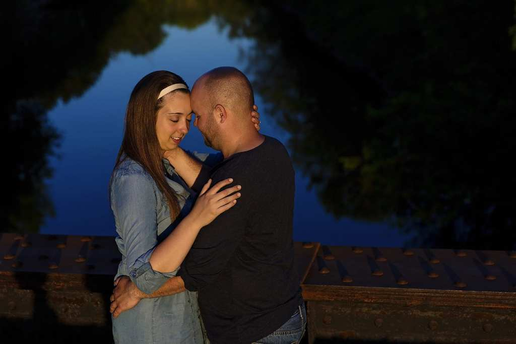 Couple outlined by reflection in river during St Raphael's engagement session