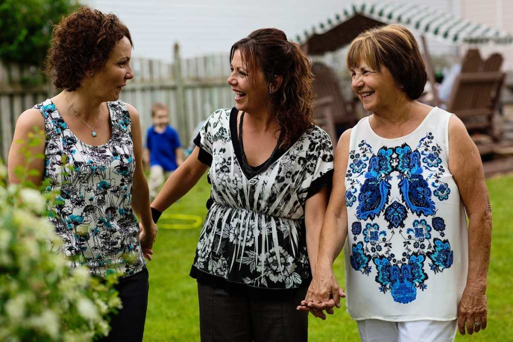 mother and daughters holding hands