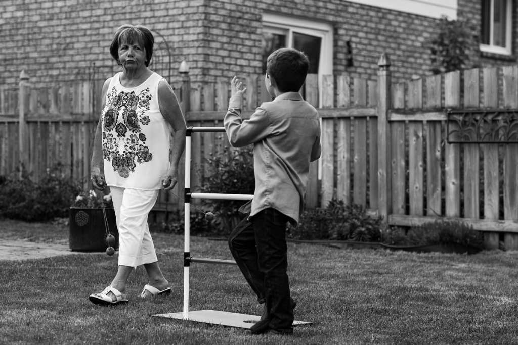 boy playing summer games with grandmother