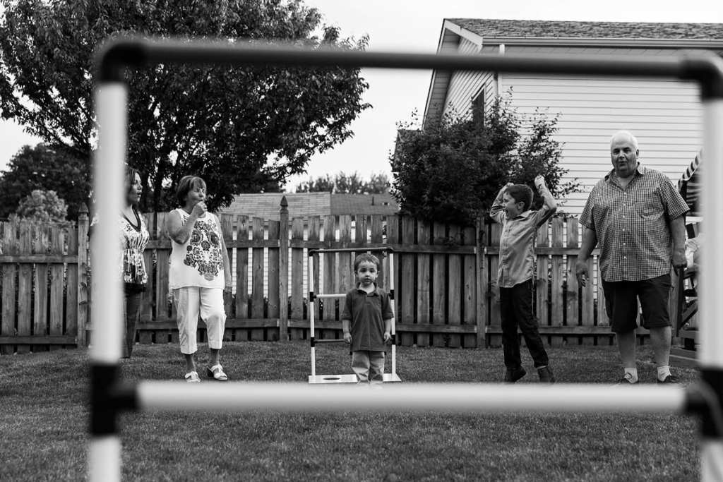 kids playing summer yard games with grandparents