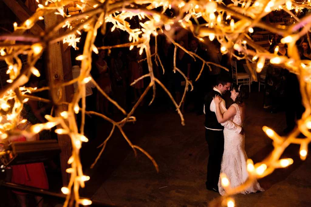 Rustic twine lighting and first dance at fairgrounds venue