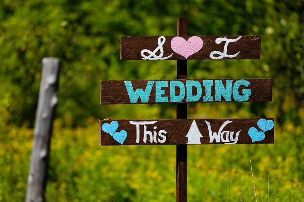 rustic wooden wedding signage in rural backyard wedding