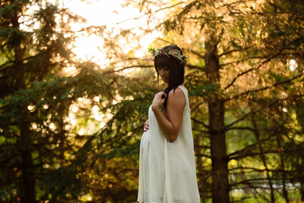Bohemian mom in sunset nature maternity session