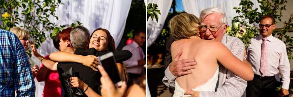 guests hugging and congratulating bride at chic cornwall summer wedding