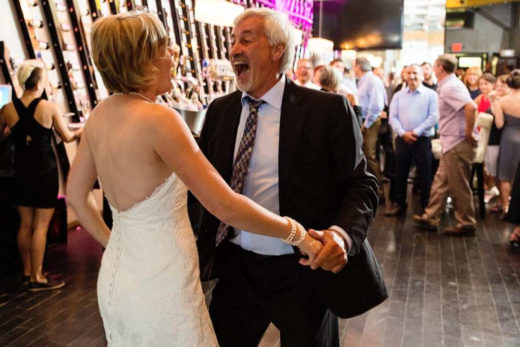 bride and father dancing and laughing at chic cornwall wedding