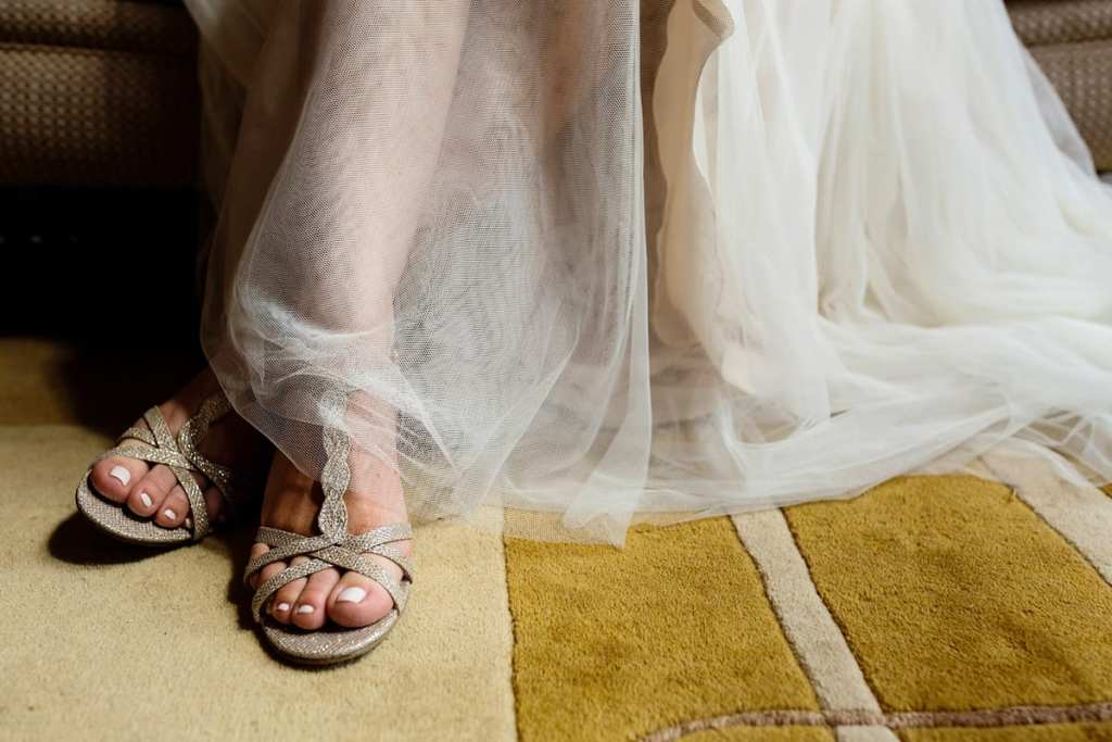 wedge wedding shoes and flowy wedding dress