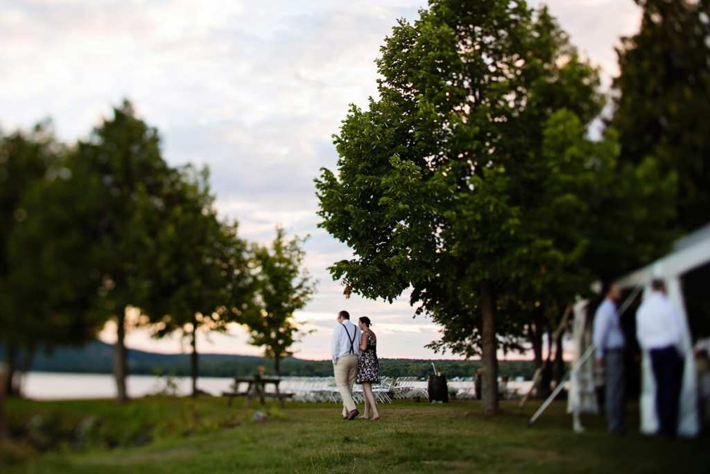guests strolling the lakeside at intimate Calabogie wedding