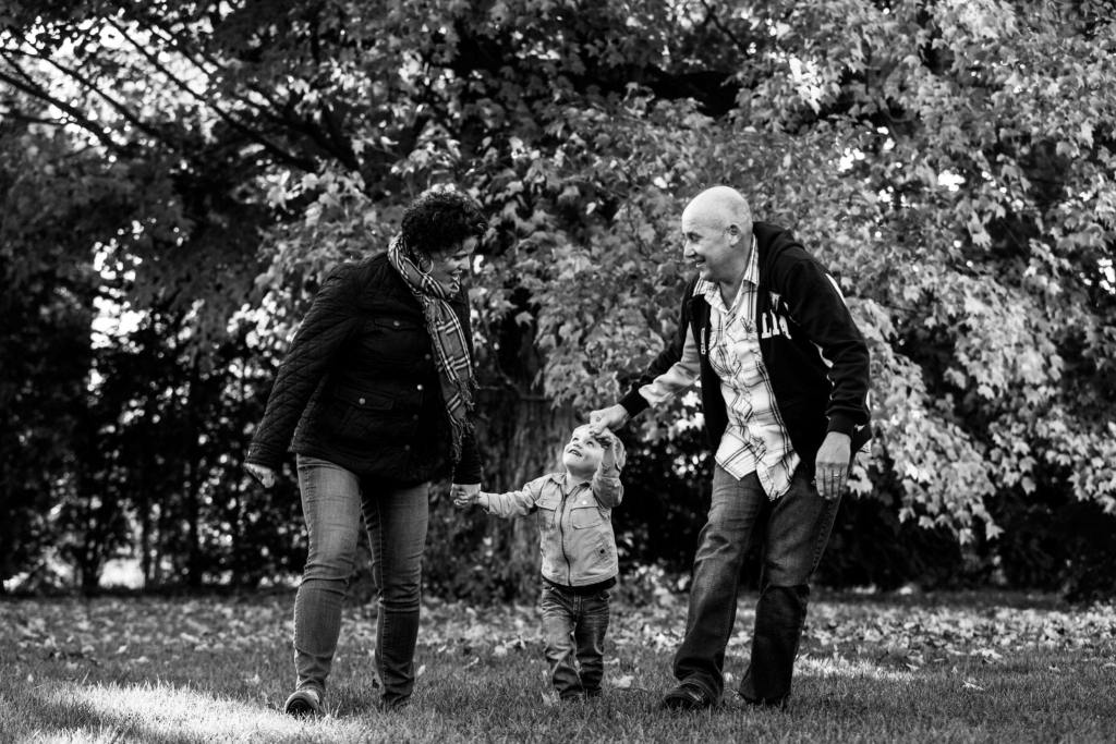young boy with parents in rural cornwall family session