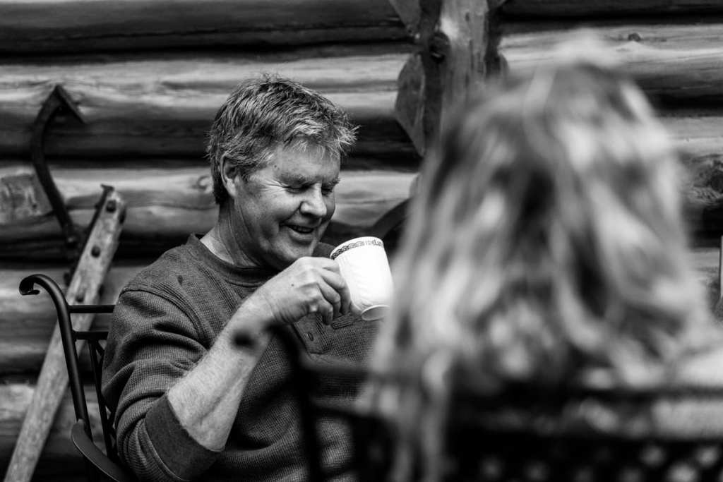 profile shot of dad enjoying coffee and family during casual ontario family session