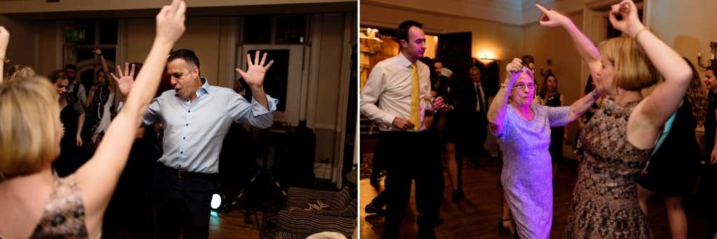 wedding guests dance with big arm gestures during wedding reception at Rhinefield House