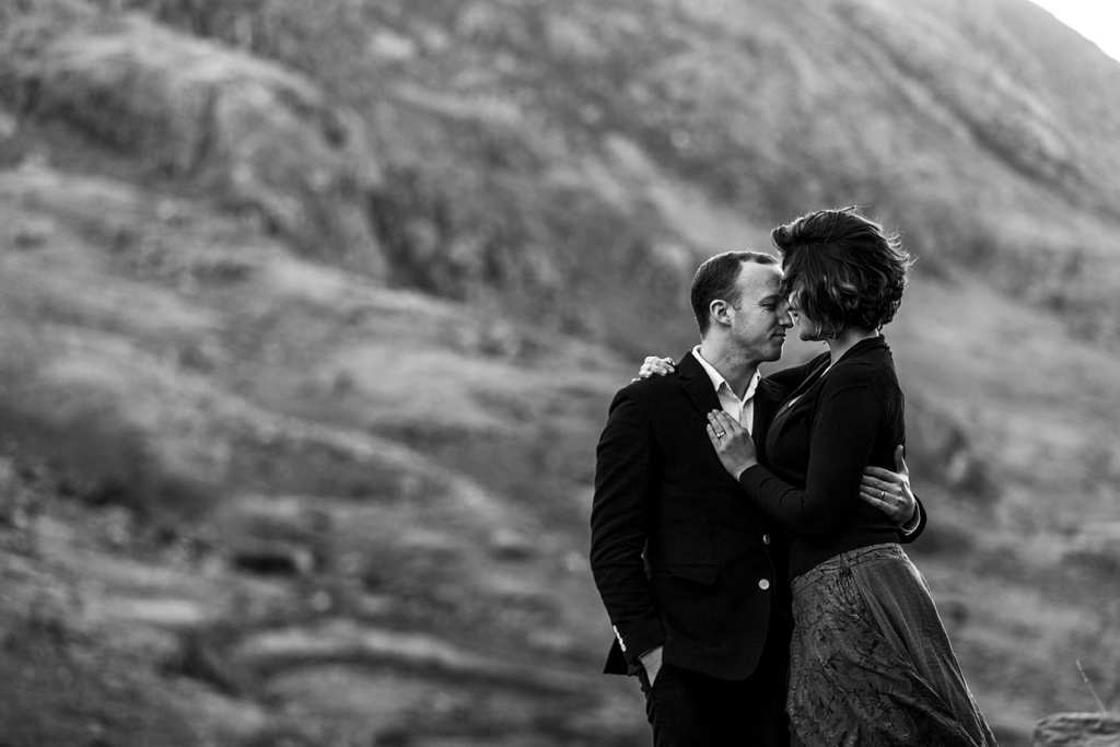 woman snuggles in to husband with mountains in the background during Snowdonia portrait session