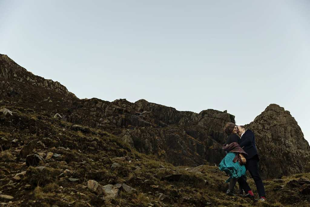 couple stand on mountainside for Snowdonia portrait session