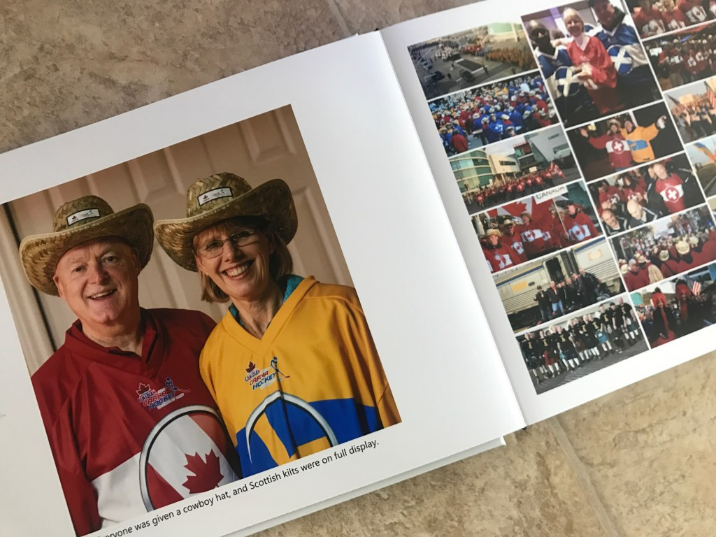Man and woman with cowboy hats and large collage page of team members