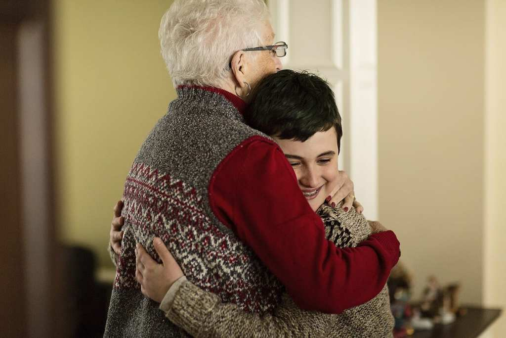 grandson hugs grandmother