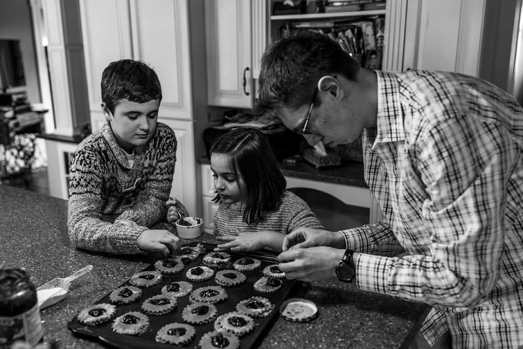 cousins bake jam cookies together
