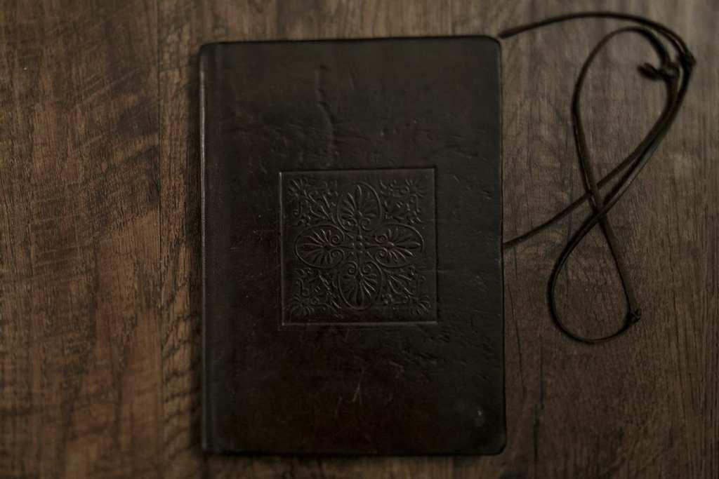 journal with ripped strap and embossed Venetian tile pattern