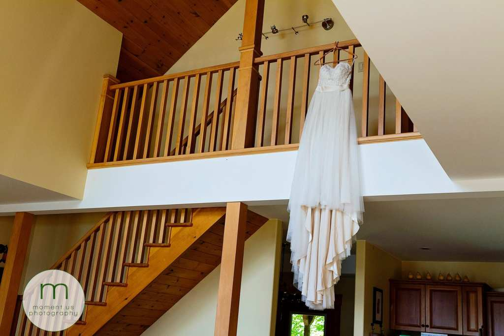 dress hangs from balcony before Calabogie wedding