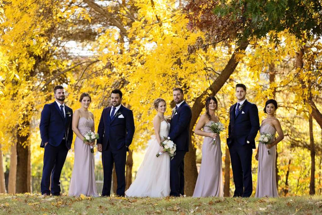 wedding party in front of yellow maples for Autumnal NAV Centre Cornwall Wedding