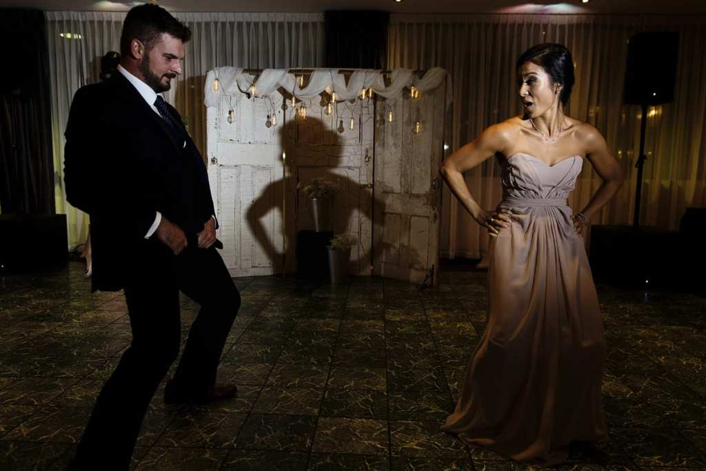 bridesmaid and groomsman dancing during entry into reception for Autumnal NAV Centre Cornwall Wedding