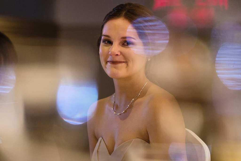 bridesmaid looking on during speeches with large bokeh spots