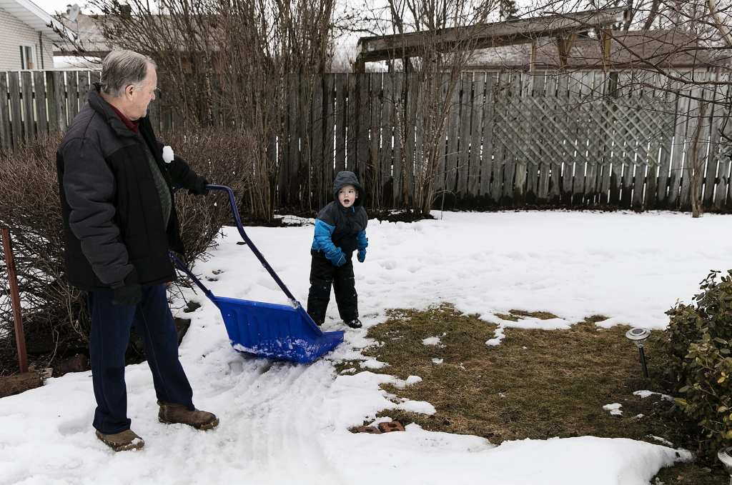 boy throws snowball at grandpa during last days of winter